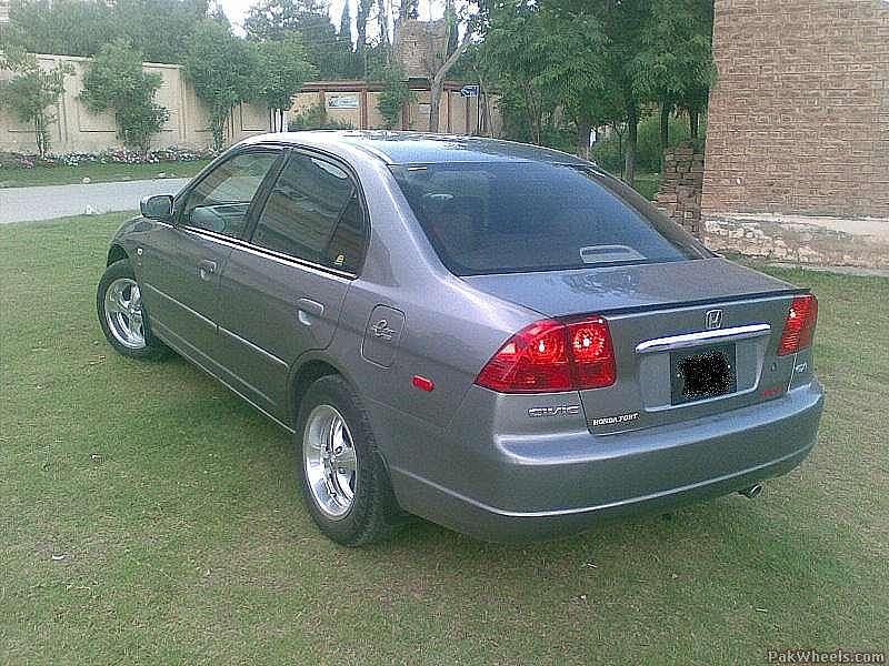 Honda Civic - 2004 stone silver Image-1