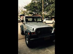 Slide_jeep-wrangler-special-edition-3-2003-13422657
