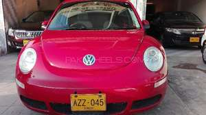 Slide_volkswagen-beetle-1-4-2008-13818261