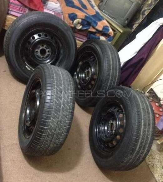 Corolla Tyres 14 number with rims and wheel cups 4 tyres Image-1