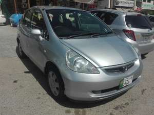 Slide_honda-fit-g-1-3-2006-15937196