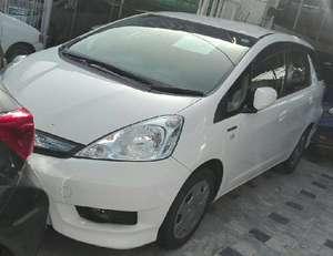 Slide_honda-fit-hybrid-2012-16089462