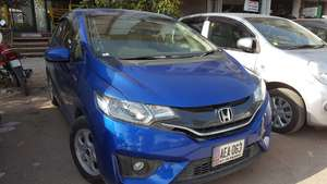 Slide_honda-fit-hybrid-f-package-2015-18411016