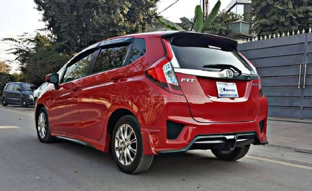 Honda fit 1 5 hybrid l package 2015 for sale in lahore for Honda motor finance phone number