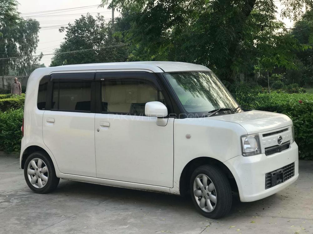 Daihatsu Move Conte CUSTOM X 2014 Image-1