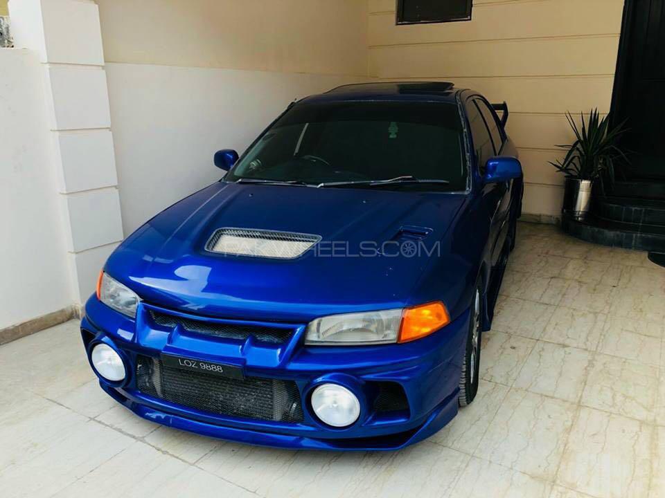 Mitsubishi Lancer Evolution - 1996 blue turd  Image-1