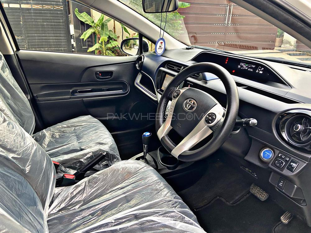 Toyota Aqua S Model Year 2016 Import Year 2020 Pearl White Color  Push Start Multimedia Steering Radar Lane Assist Traction Control DVD TV Back Camera And much more