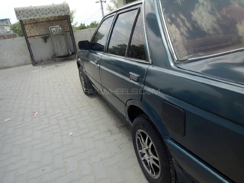 Nissan Sunny EX Saloon 1.6 (CNG) 1989 Image-1