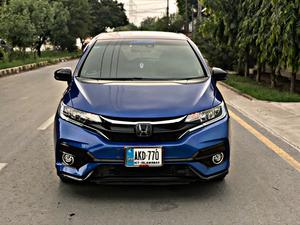 Honda Fit RS Sensing New Shape Model Year 2017 Import and Registered 2019 LED Projection Head Lamps Extended Bumpers Extended Spoiler Side Skirts Led Chrome Fog Lamps Body kits Sensing Package Lane Departure Assist With Steering Control Adaptive Cruise Control 11 Inch Android Panel Sub Woofer Parking Assist And much more