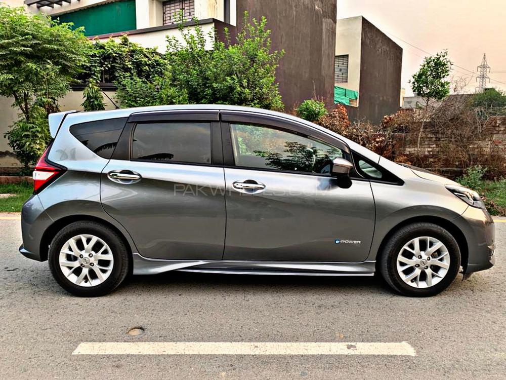 Nissan Note Medalist Grey Color Model Year 2017 Import Year 2020 Multimedia Steering Dedicated Camera for rear view mirror 4 Cameras with bird eye view Radar lane Departure Assist  DVD TV Alloy Wheels LED Projection Lamps Side Skirts Rear Spoiler