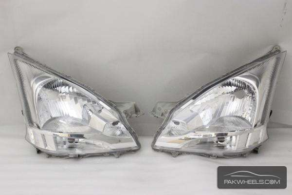 daihatsu move la100 head light pair For Sale Image-1
