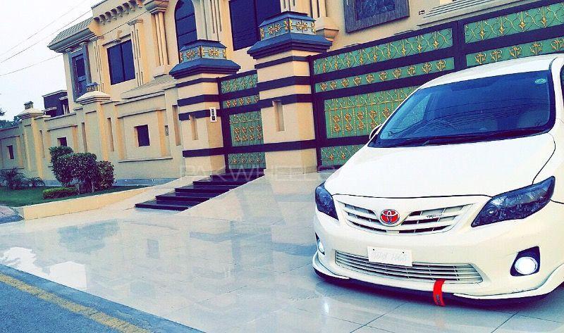 Toyota Corolla - 2011 White Horse Image-1
